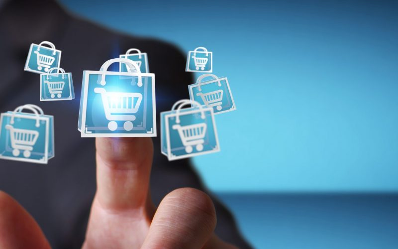 Businessman,On,Blurred,Background,Using,Digital,Shopping,Icons,3d,Rendering